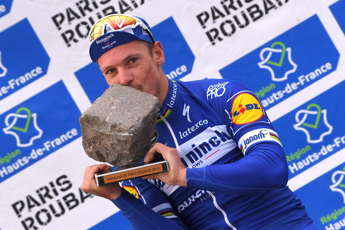 ROUBAIX, FRANCE - APRIL 14: Podium / Philippe Gilbert of Belgium and Team Deceuninck-QuickStep / Celebration / Trophy / during the 117th Paris-Roubaix a 257km race from Compiègne to Roubaix / @Paris_Roubaix / #ParisRoubaix / PRBX / L'Enfer du Nord / on April 14, 2019 in Roubaix, France. (Photo by Luc Claessen/Getty Images)
