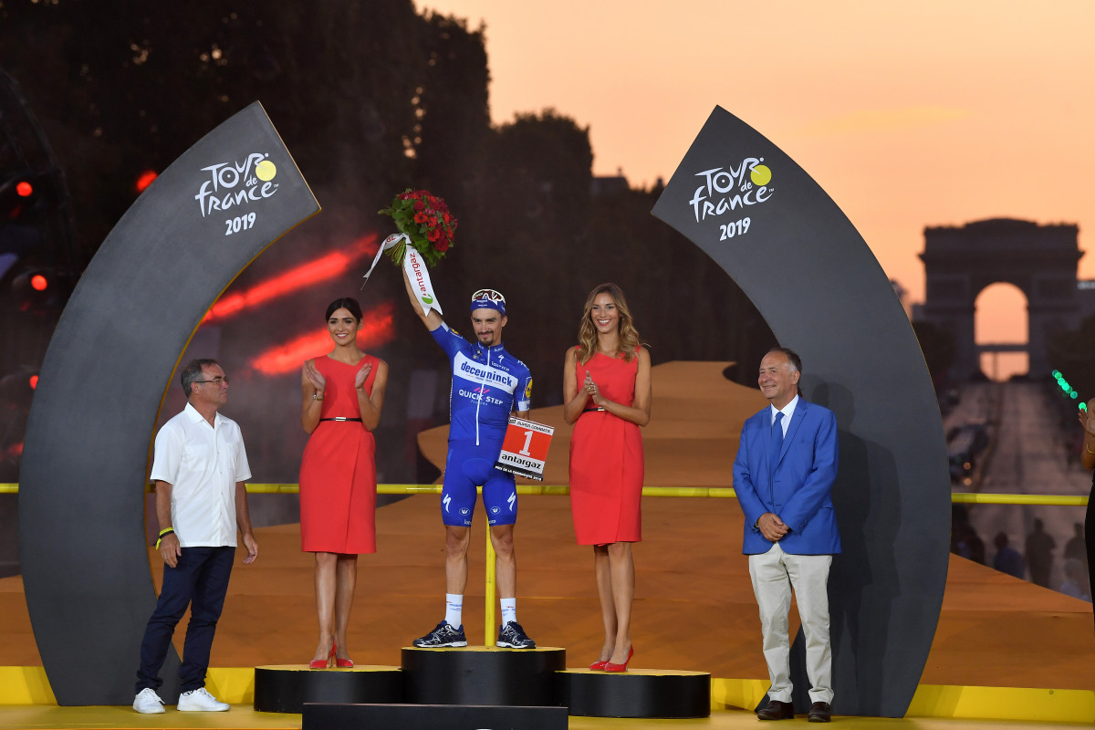 PARIS, FRANCE - JULY 28: Podium / Julian Alaphilippe of France and Team Deceuninck - Quick-Step Most Combative Rider / Celebration / Bernard Hinault of France Ex Pro-Cyclist / Miss / Hostess / Arc De Triomphe / during the 106th Tour de France 2019, Stage 21 a 128km stage from Rambouillet to Paris Champs-Élysées / TDF / #TDF2019 / @LeTour / on July 28, 2019 in Paris, France. (Photo by Justin Setterfield/Getty Images)